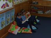 The girls having quiet time in the library corner.